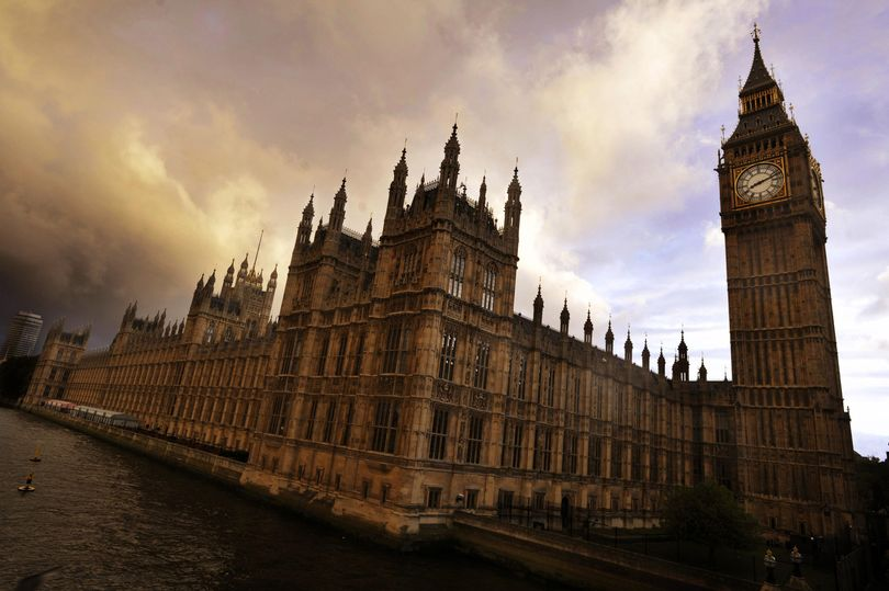 Tory MP 'arrested on suspicion of raping parliamentary worker'