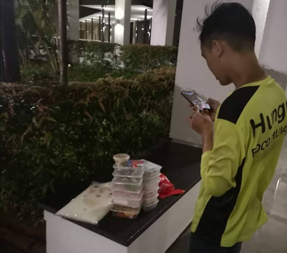 Penang woman praised for helping food delivery rider caught in the rain