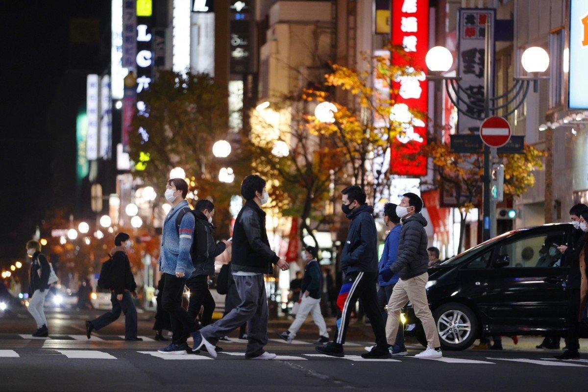 Japan warned of coronavirus 'third wave', as cases soar in Hokkaido and Tokyo