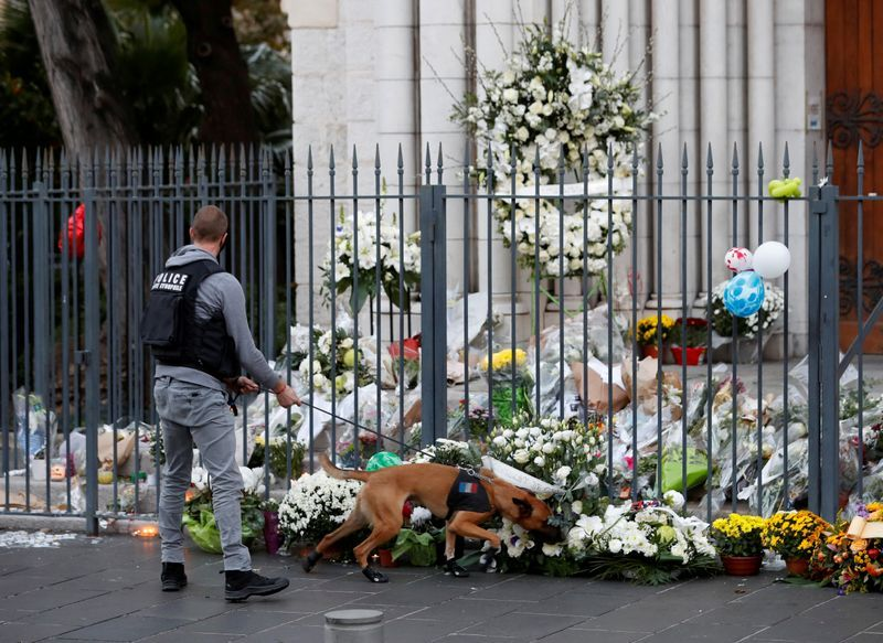 French prosecutors: Nice church attack and teacher's beheading are linked