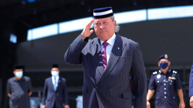 The Sultan of Johor confers DMIJ on four individuals
