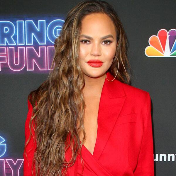 """Chrissy Teigen Shuts Down """"Weird and Angry"""" Twitter Troll Who Called Her """"Classless"""""""
