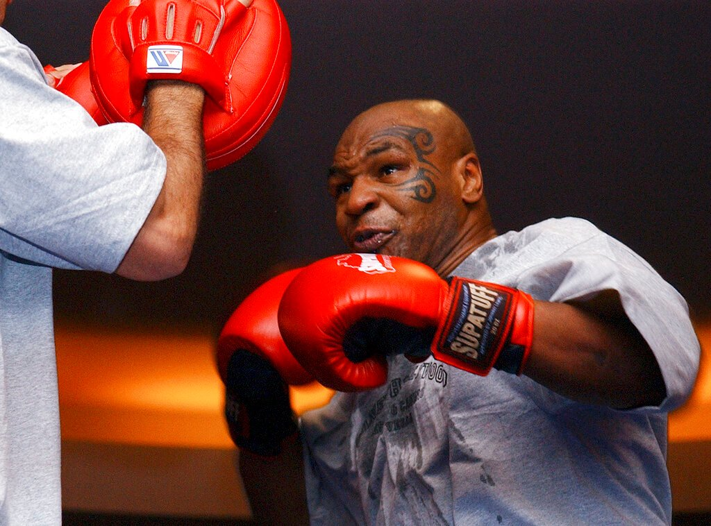Tyson's ring return after 15 years ends deadlocked against Jones