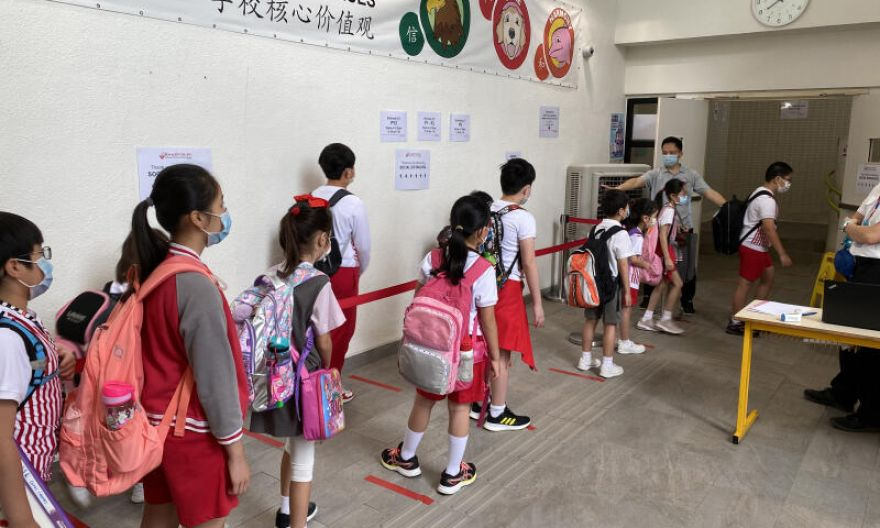 Hong Kong suspends in-person school lessons as Covid-19 cases climb