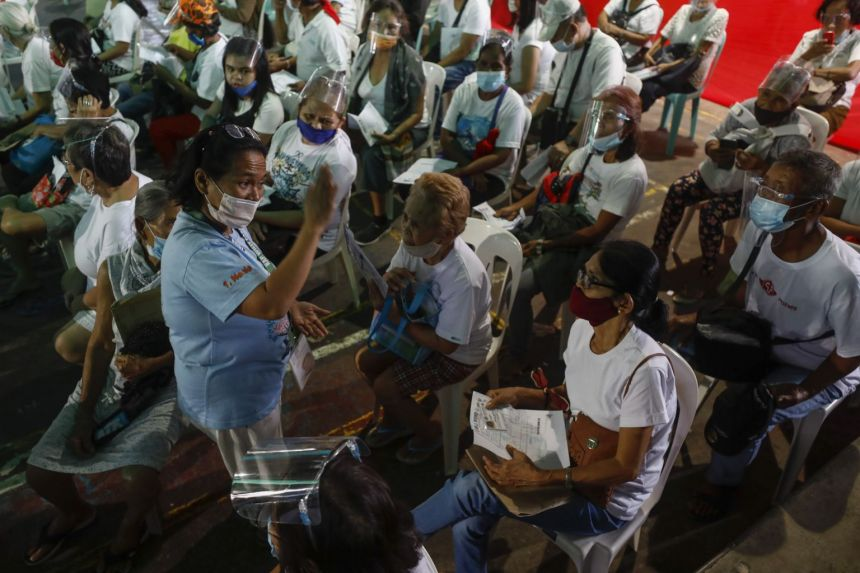 Philippines extends partial coronavirus curbs in Manila to end of year