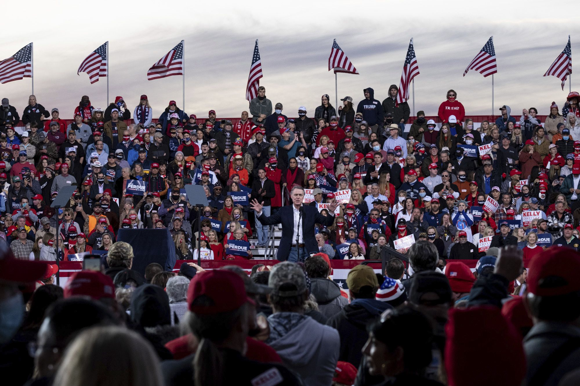 The Latest: Trump urges backers to 'take revenge' by voting