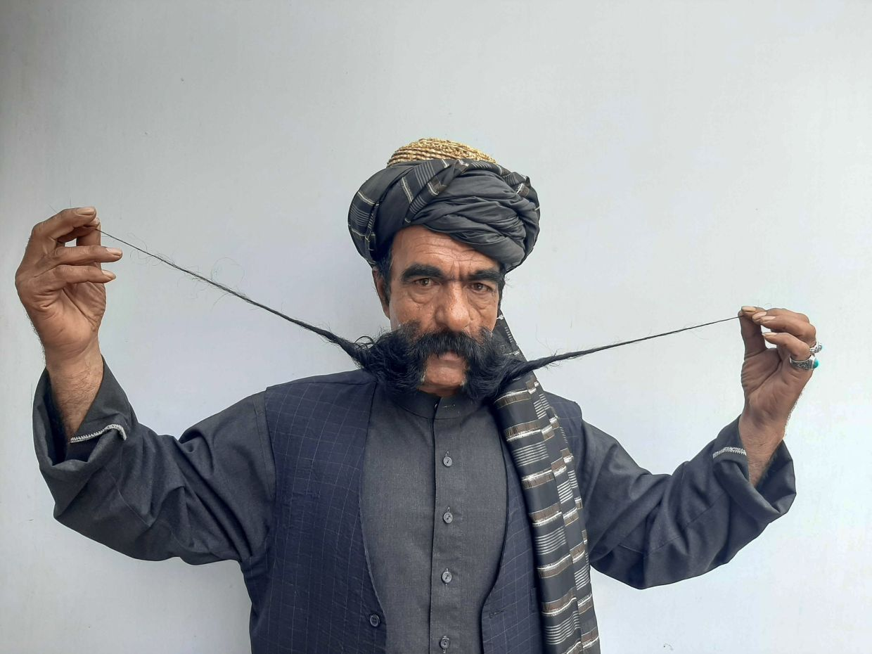 Kabul tailor's 60cm-long moustache has made him a local celebrity in Afghanistan