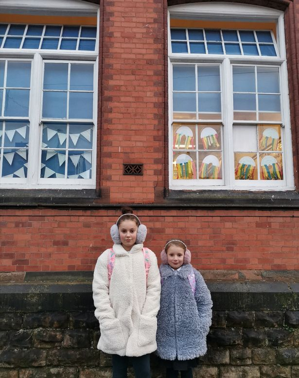 Mum forced to send daughters, 6 and 9, to school in earmuffs as windows kept open