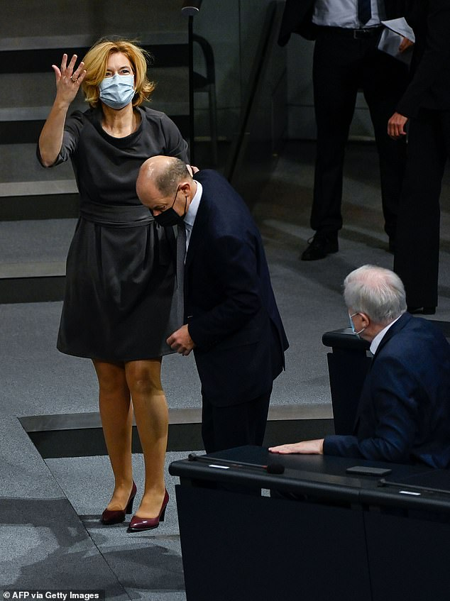 Merkel minister takes a tumble: German agriculture secretary trips on a step, rips her tights and loses her glasses during Bundestag debate