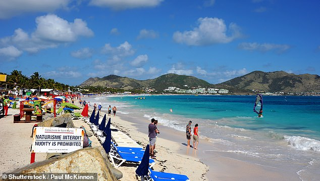 Female tourist, 39, is killed after shark rips her leg off as she swam off of Caribbean island Saint Martin