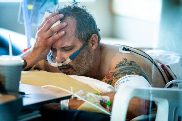 Tragic last photo shows dad with Covid-19 struggling to breathe before dying