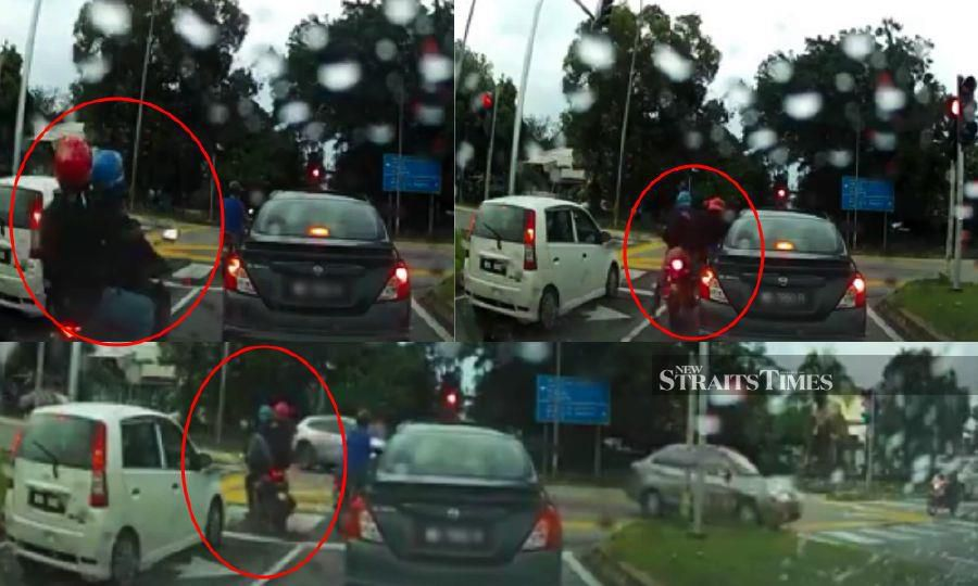 Watch: Man on motorcycle smashes car window, attempts to snatch driver's purse