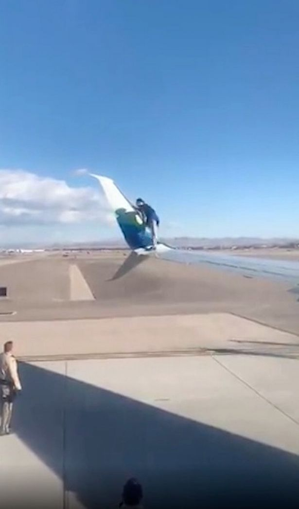 Man arrested after climbing onto wing of passenger jet moments before take-off