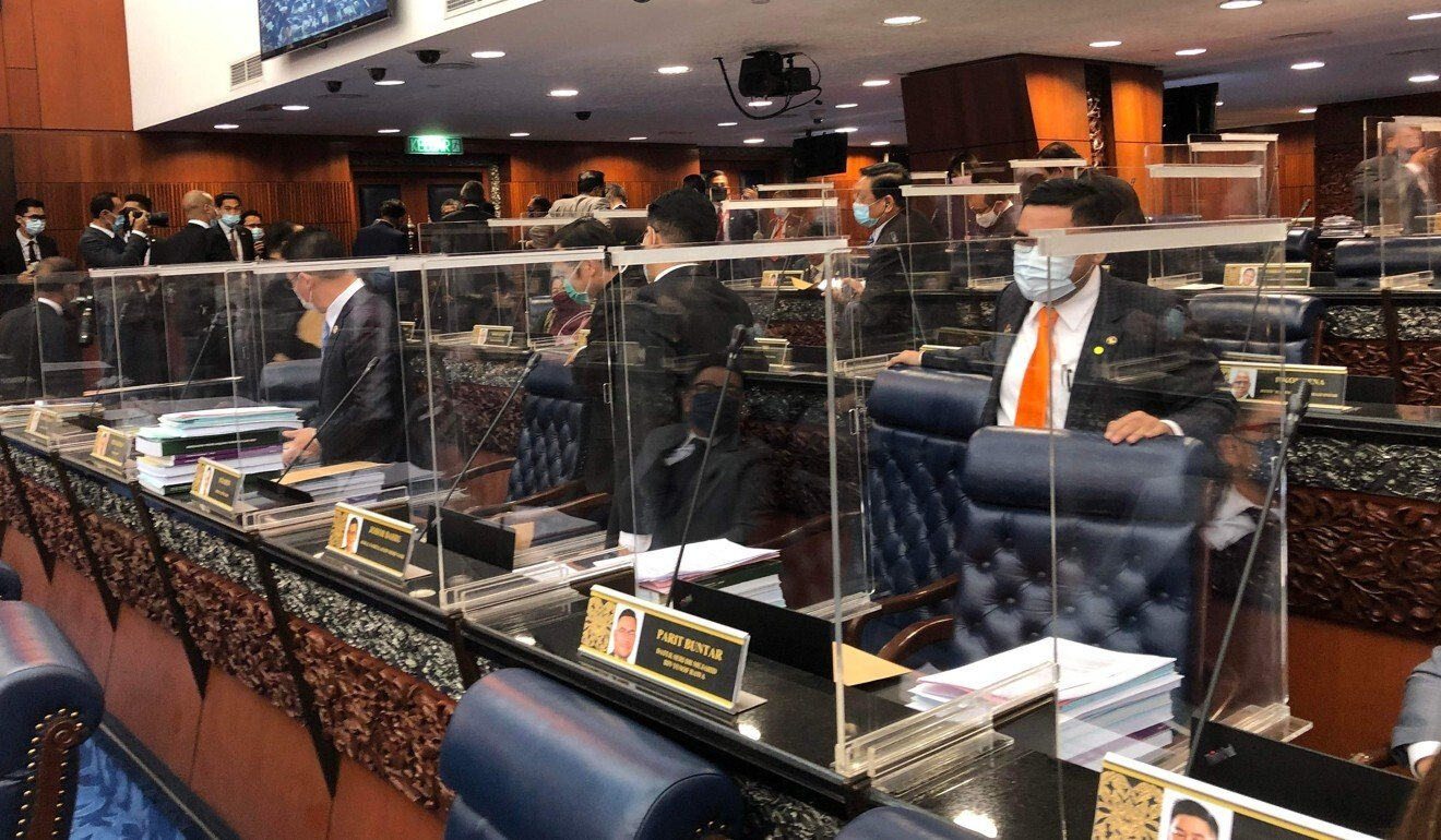 Malaysia opposition stage walkout after ministers exposed to Covid-19 enter parliament wearing PPE
