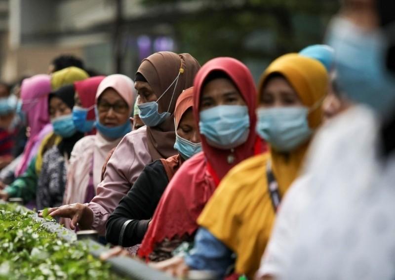 Malaysian women and children bear brunt of coronavirus lockdown