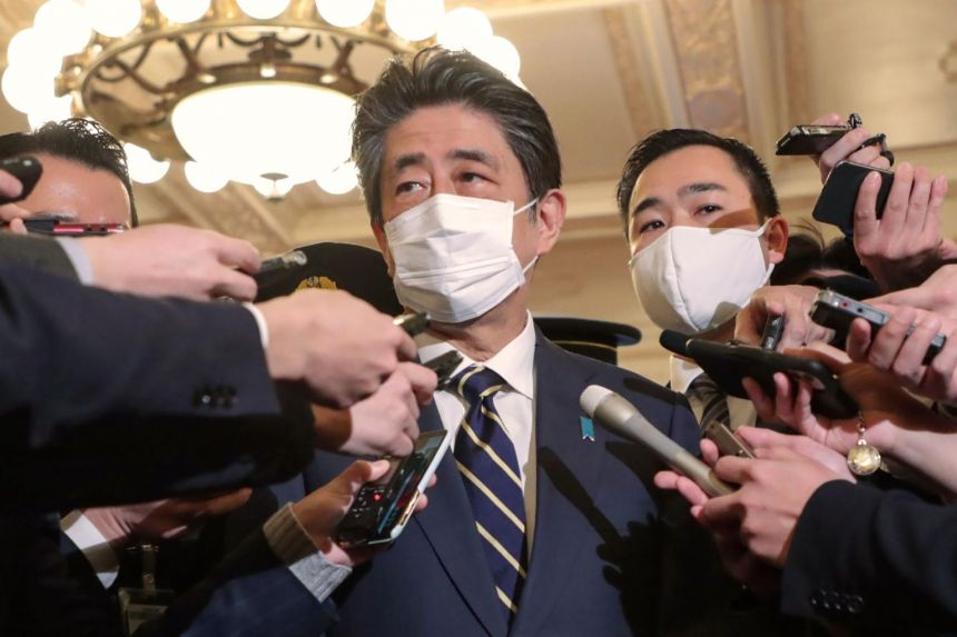 Japan ex-premier Abe questioned by prosecutors on party funding