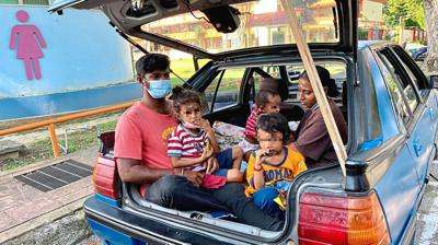Family of five living in old car
