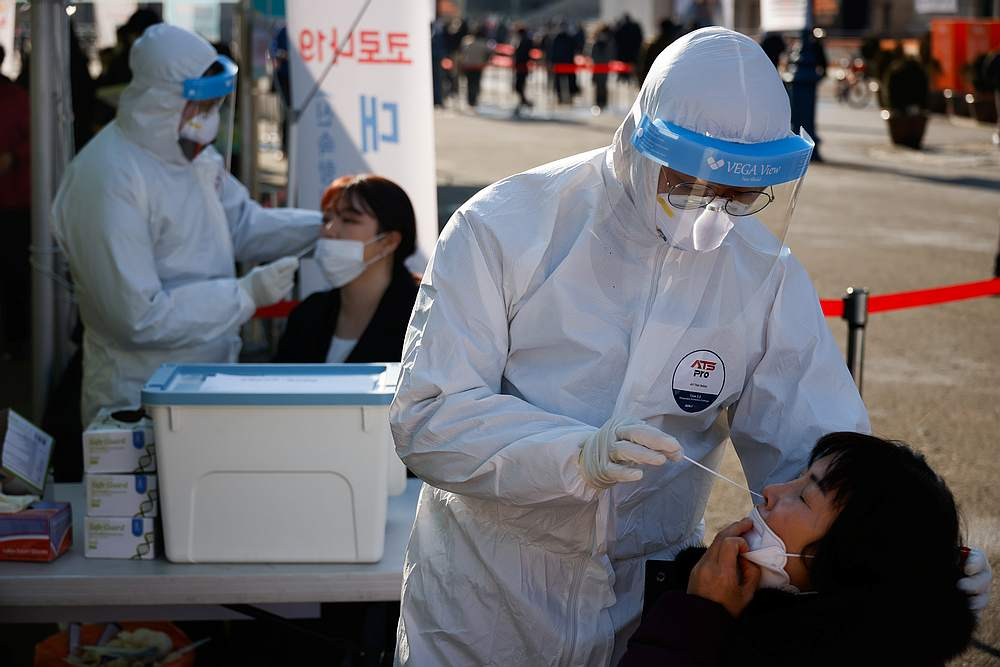 S.Korean regions brush off outcry, mandate coronavirus testing for foreign workers