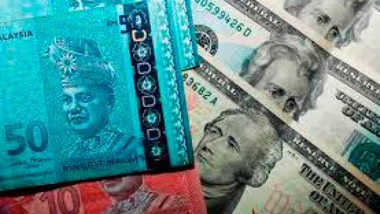 Ringgit pares earlier losses to end higher against US Dollar