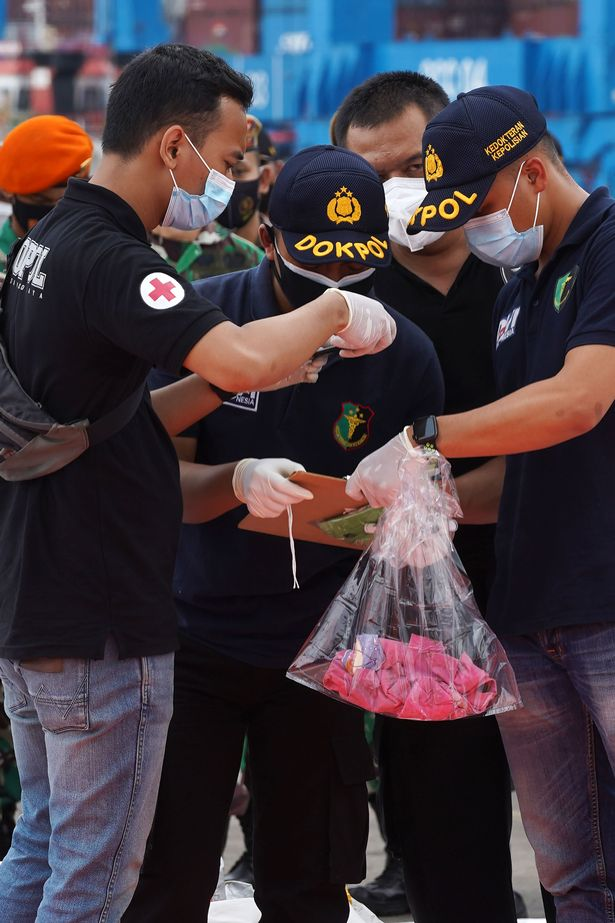 Indonesia plane crash: Flight attendant identified as first victim by fingerprints