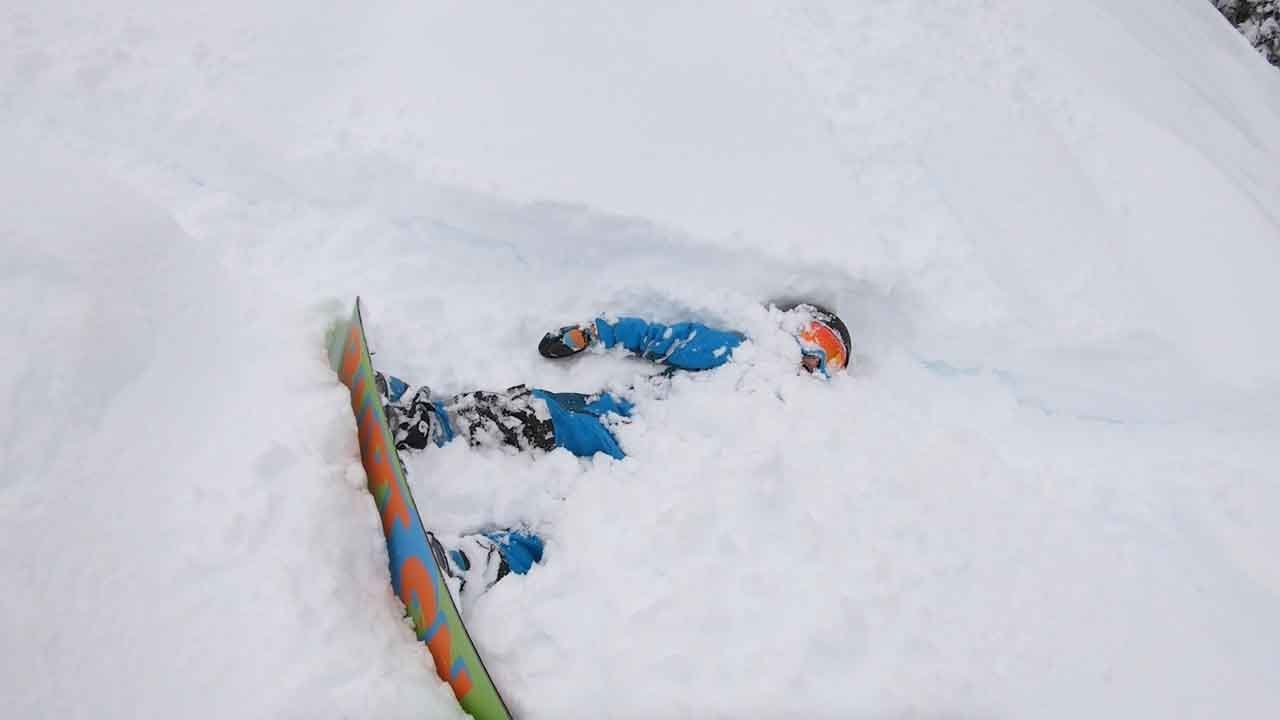 Kid Falls While Snowboarding And Gets Stuck In Snow