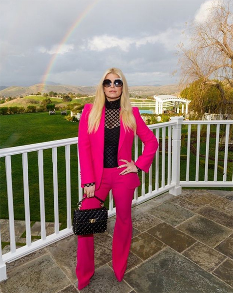 Jessica Simpson pulls off hot pink suit in celebratory family photo