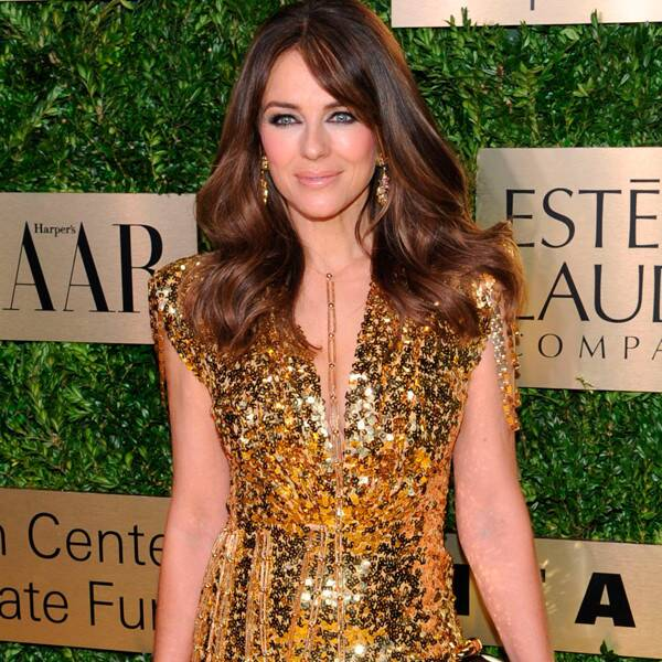 """Elizabeth Hurley Hits Back at Haters After Posting Topless Photos """"Taken By My 80-Year-Old Mother"""""""