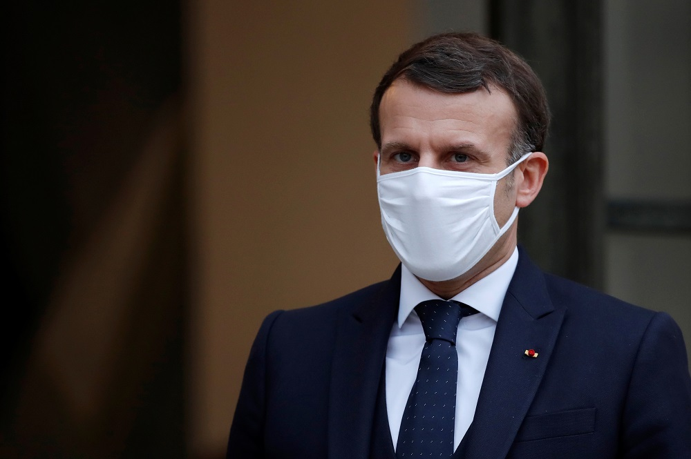 Macron announces school closures in France and defends strategy