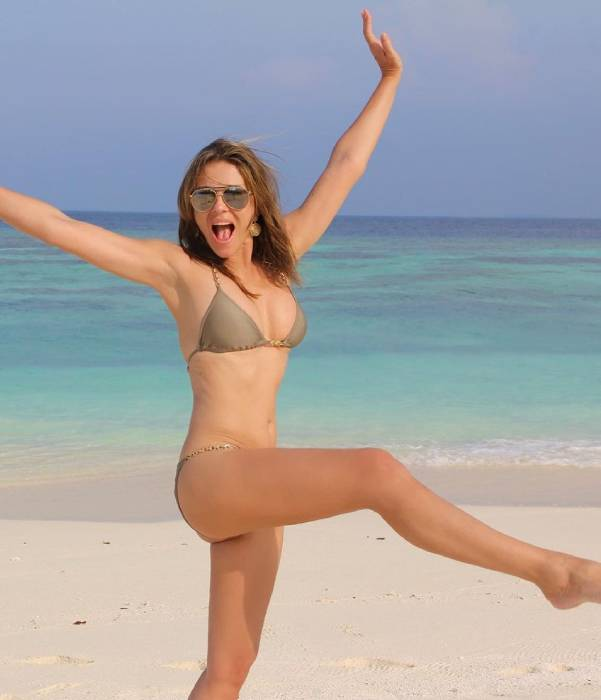 Elizabeth Hurley sunbathes in a sequined bikini for show-stopping selfie