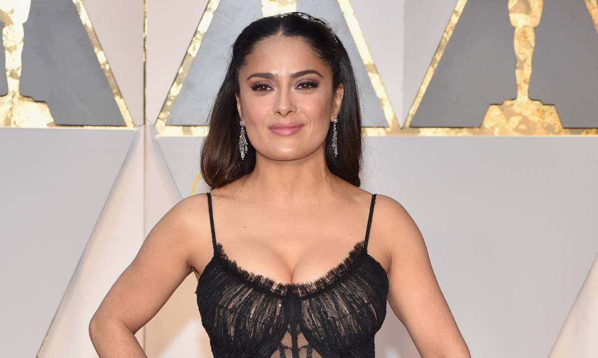 Salma Hayek doing the floss in a lace dress will make your day