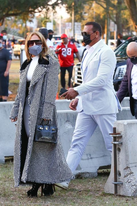 J.Lo Wore a Sweeping Houndstooth Coat and Tiny Louis Vuitton Crop Top to the Super Bowl