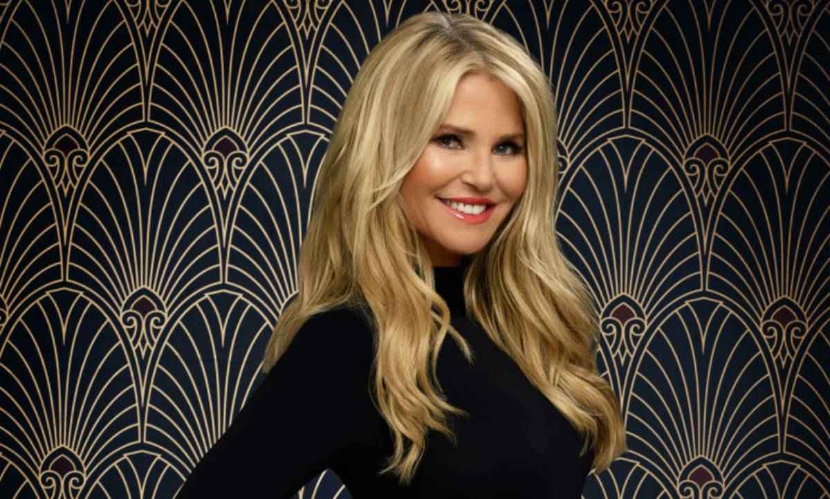 Christie Brinkley turns heads in fitted scooped vest and high waisted trousers