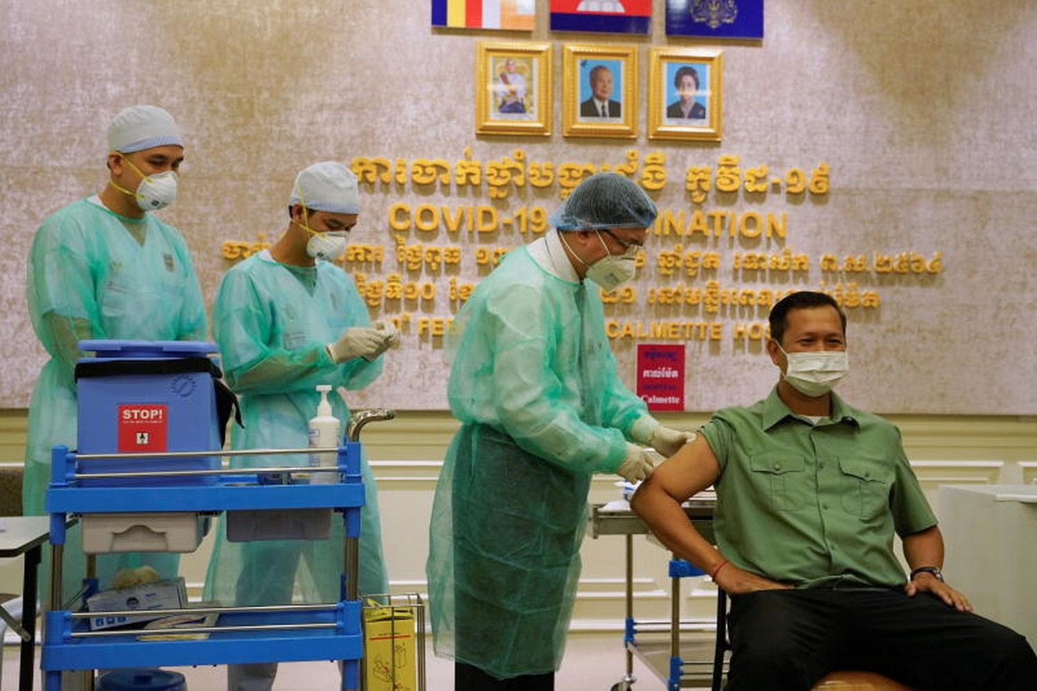 Cambodia begins Covid-19 vaccinations with shots for PM's sons, ministers