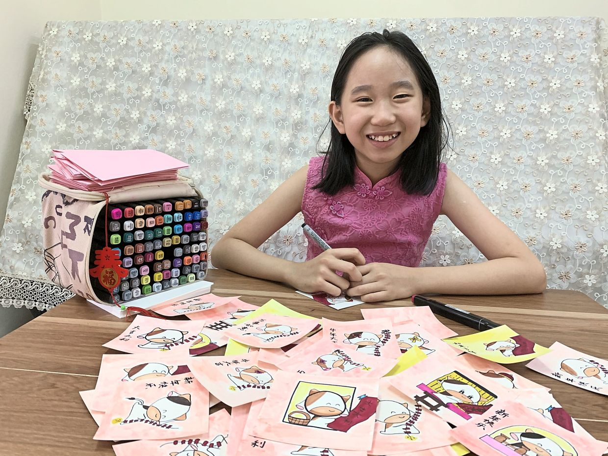 11-year-old raises RM713 with hand-drawn CNY cards
