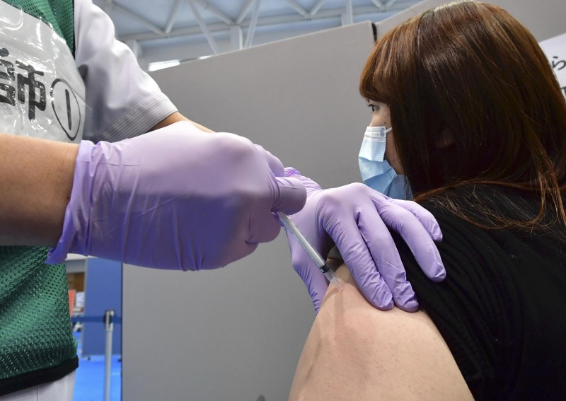 Japan to compile weekly reports on vaccine side effects