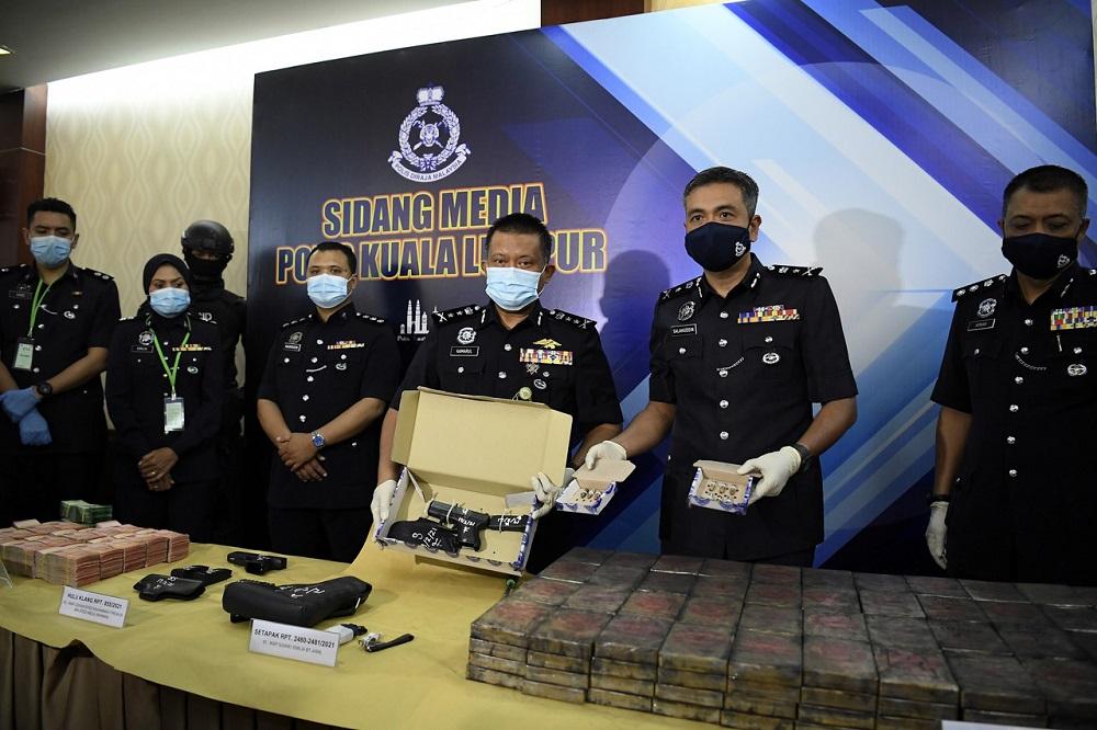 Cops nab woman mastermind, seize heroin base worth RM7.8m in KL drug bust