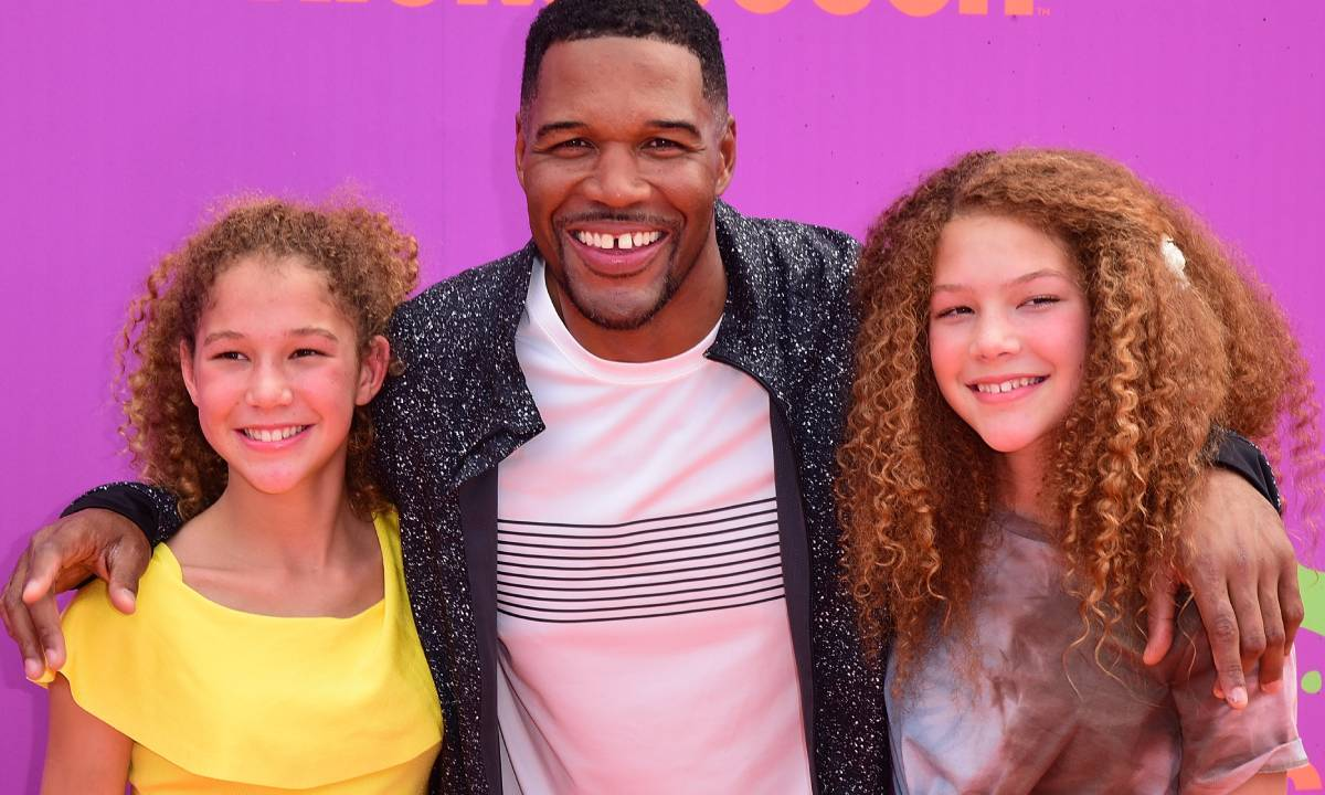 Michael Strahan's twins steal the show as they model famous dad's collection