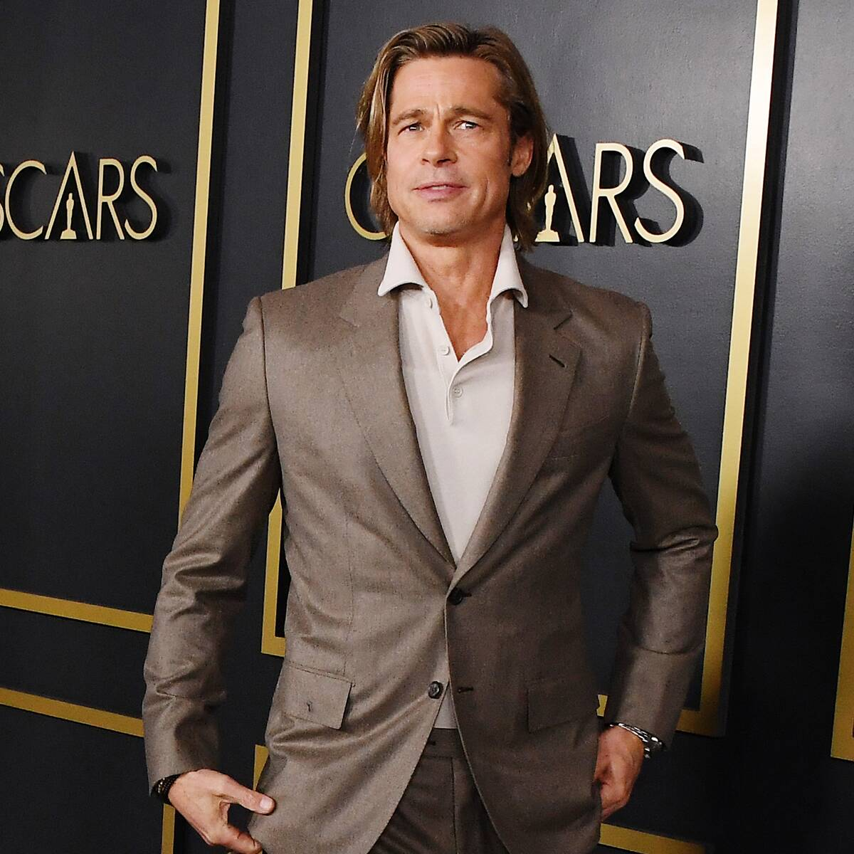 You Need to See Brad Pitt's Teeny-Tiny Ponytail Because We Have Questions
