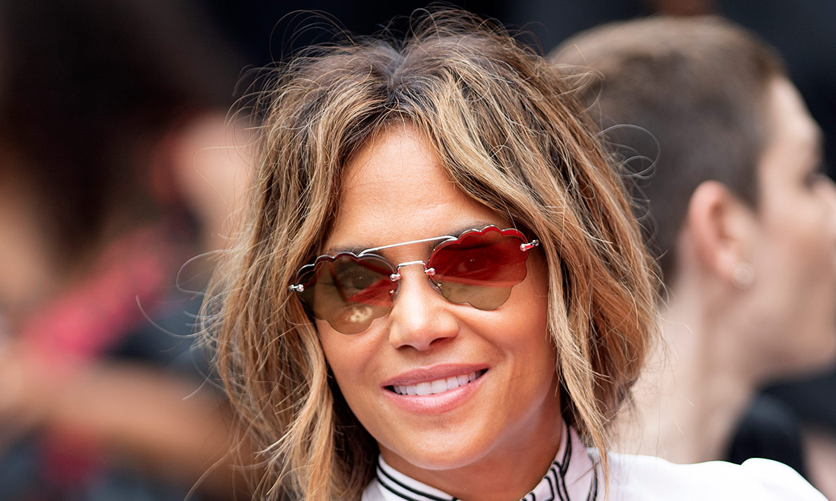 Halle Berry showcases toned legs as she poses in shirt and heels