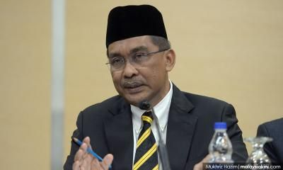 Law minister doesn't want any more challenges to state syariah law