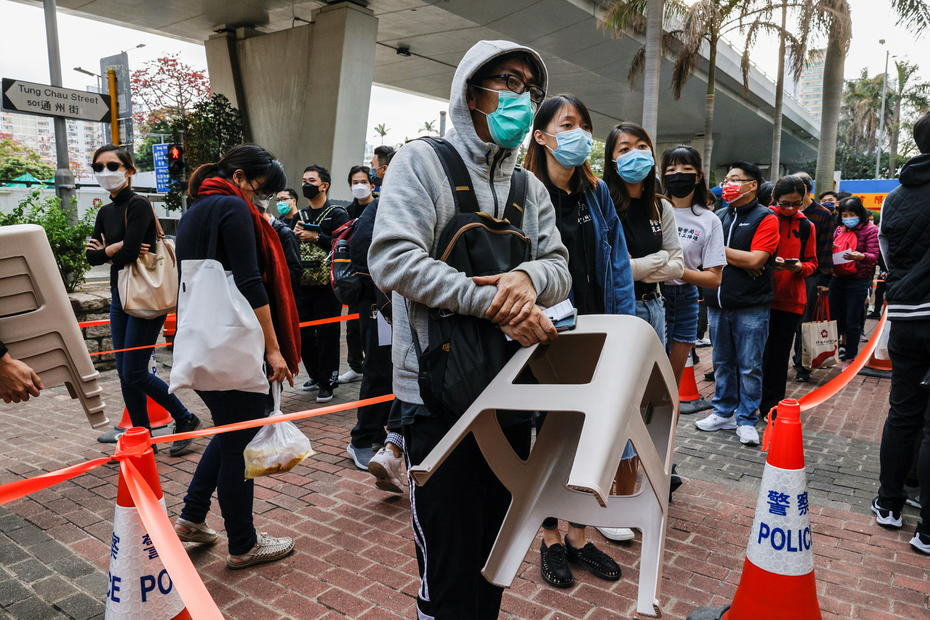Hong Kong activists chant protest slogans as crowds gather for subversion hearing