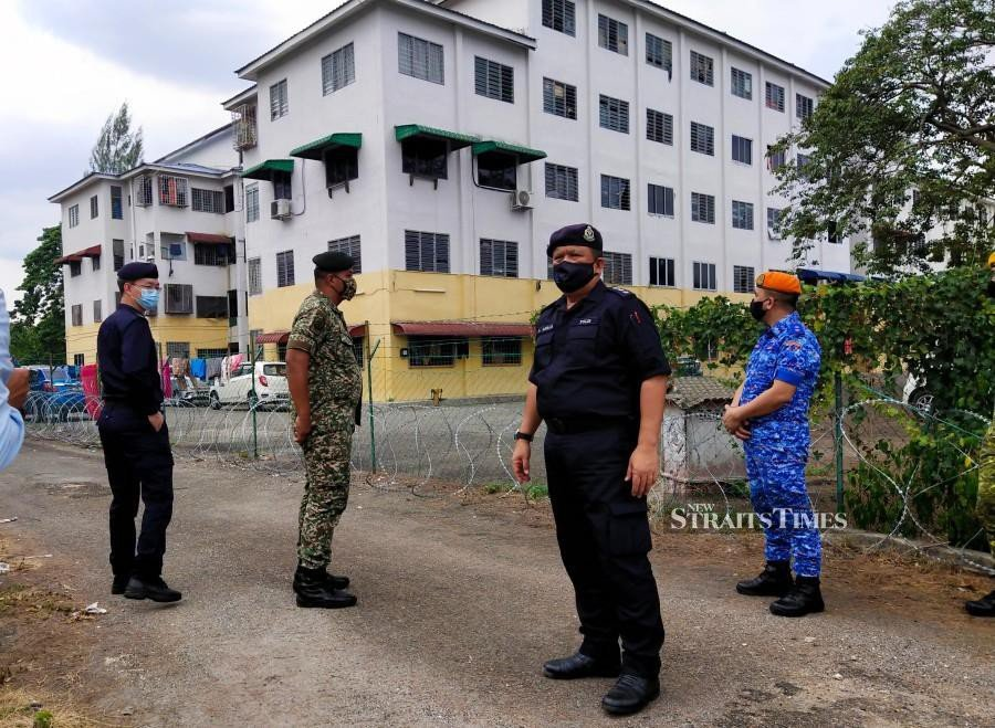 EMCO in Ipoh flat: Cops locate 22 foreign workers, one still missing