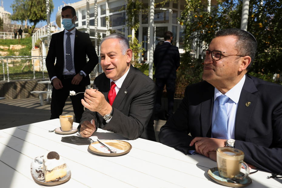 We're almost done with COVID curbs, Netanyahu says as Israel reopens restaurants