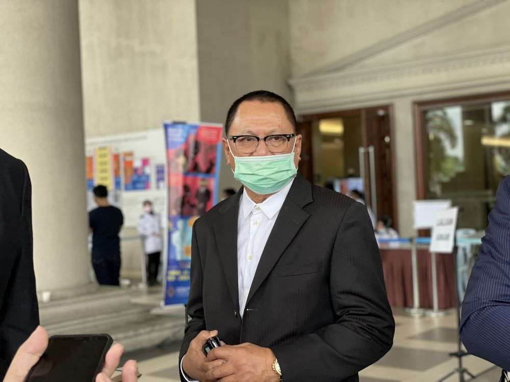 Hearing of Umno Supreme Council member Puad Zarkashi's application to set aside injunction order obtained by Muhyiddin on July 26