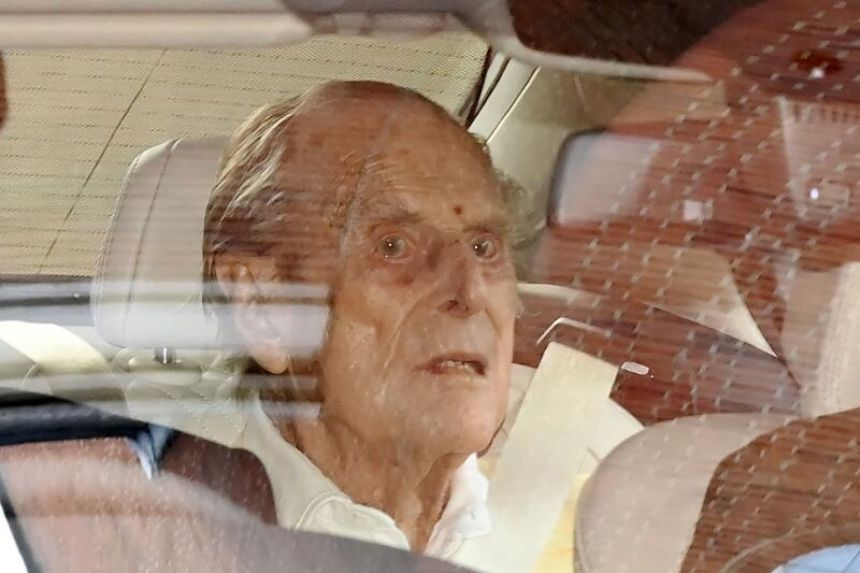 Britain's Prince Philip leaves hospital after treatment