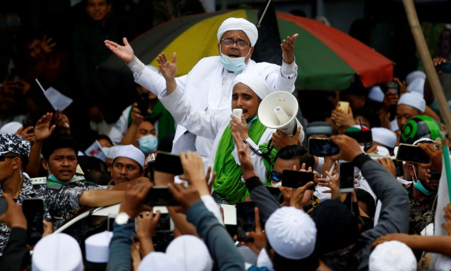 Indonesian cleric accused of incitement, breaking Covid-19 rules over celebrated homecoming