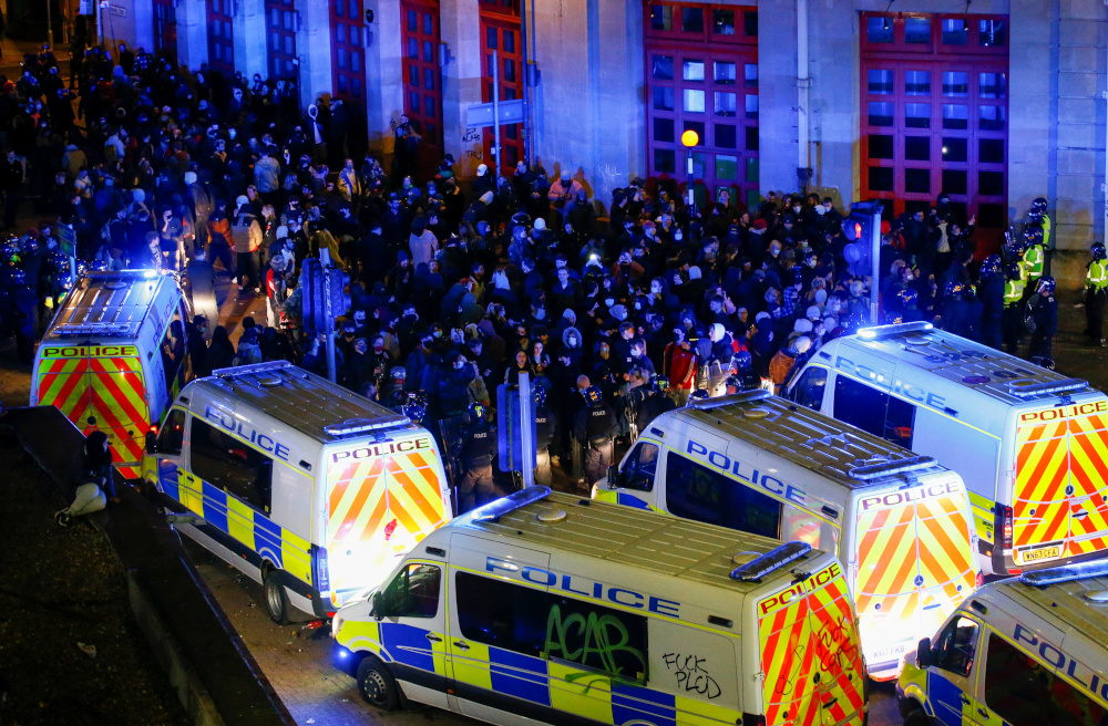 Protesters against policing bill clash with officers in Bristol, England