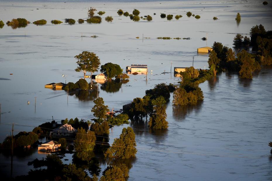 Australia remains on flood watch even as rains ease