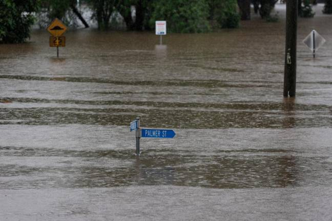 Australian floods kill 2, more evacuations as clean-up begins