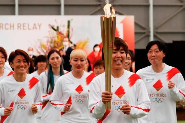 Tokyo Olympics torch relay starts in Fukushima's shadow